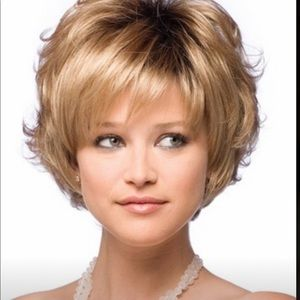Vivacious blond wig. Can be combed down.